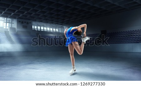 Figure skating girl in ice arena #1269277330