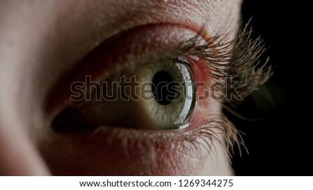 close up macro human eye opening blinking light revealing beautiful iris #1269344275