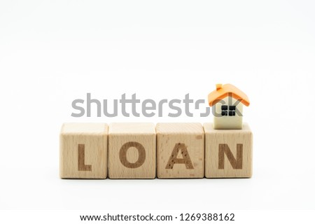 "House model on wooden word block ""LOAN"". Concept for property ladder, mortgage and real estate investment . #1269388162"