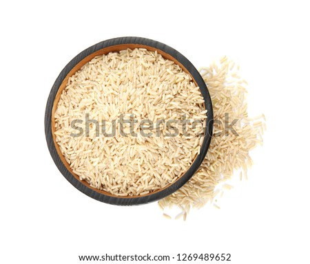 Plate with raw unpolished rice on white background, top view #1269489652