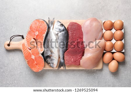 Set of natural food high in protein on grey background, top view #1269525094