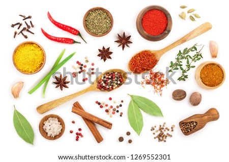 mix of spices in wooden spoon isolated on a white background. Top view. Flat lay. Set or collection #1269552301