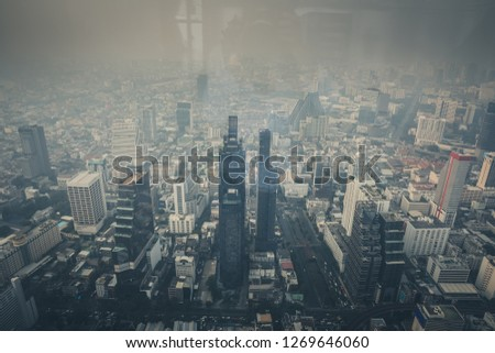 Bangkok, Thailand - December 20, 2018 : Cityscape of Bangkok the capital cities of Thailand covered by mixture of dust in air pollution, it is unhealthy. Taking photo pass glass. #1269646060