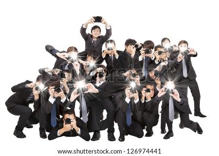 many photographers holding camera pointing to you and isolated on white Royalty-Free Stock Photo #126974441