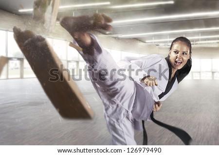 Applying focus and power (Martial arts) Royalty-Free Stock Photo #126979490