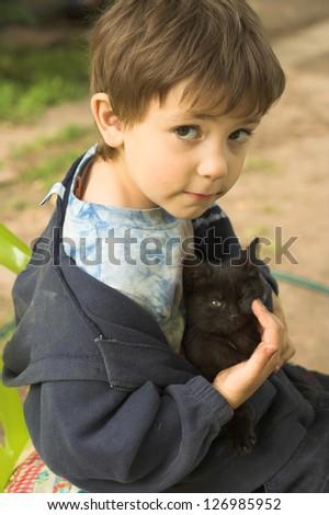 funny boy with black kitten #126985952