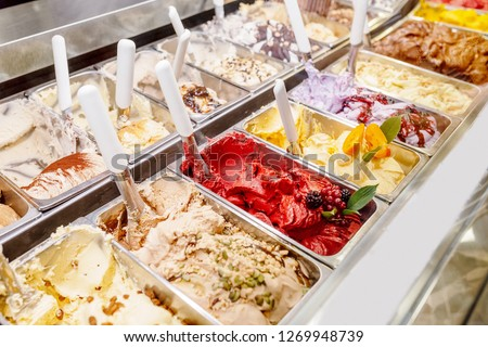 various flavors of gelato ice-cream at the showcase in dessert shop #1269948739