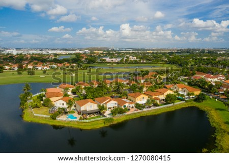 Aerial drone footage of residential homes in the City of Pembroke Pines Florida USA #1270080415