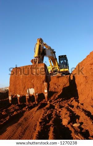 Yellow construction vehicle working #1270238