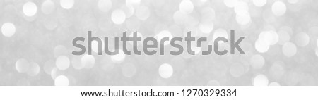 silver and white bokeh lights defocused. abstract background #1270329334