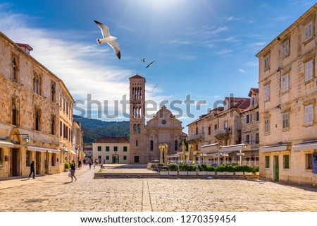 Main square in old medieval town Hvar with seagull's flying over. Hvar is one of most popular tourist destinations in Croatia in summer. Central Pjaca square of Hvar town, Dalmatia, Croatia.  #1270359454