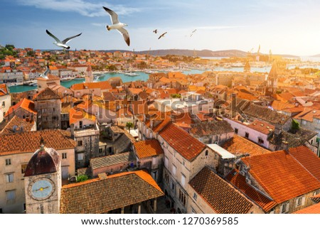 View at town Trogir, old touristic place in Croatia Europe with seagull's flying over city. Trogir town coastal view. Magnificent Trogir, Croatia. Sunny old Venetian town, Dalmatian Coast in Croatia. #1270369585