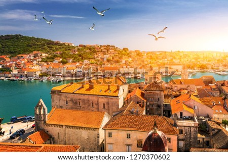 View at town Trogir, old touristic place in Croatia Europe with seagull's flying over city. Trogir town coastal view. Magnificent Trogir, Croatia. Sunny old Venetian town, Dalmatian Coast in Croatia. #1270370602