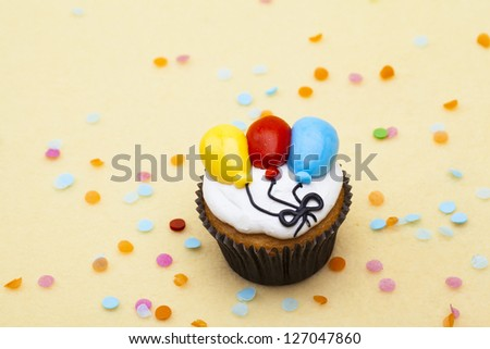 Top view of a cupcake with balloon design.