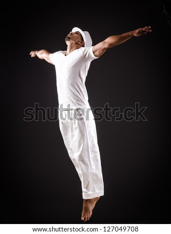 Dancer dancing dances in white clothing #127049708