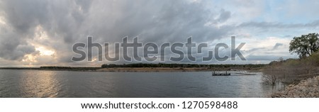 Panoramic View of Large Lake With Broken Dock With Storm Clouds #1270598488