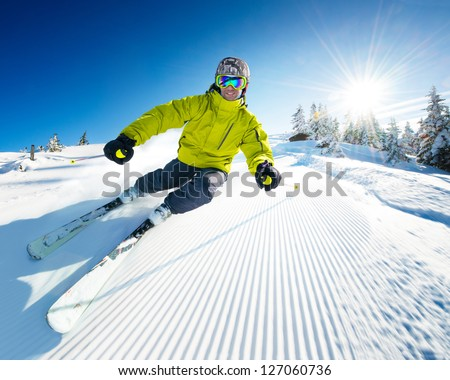Skier on piste in high mountains #127060736