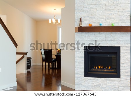 Interior design of modern Living room with fireplace in a new house #127067645