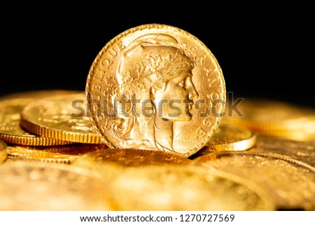 Real Gold coins over dark background #1270727569