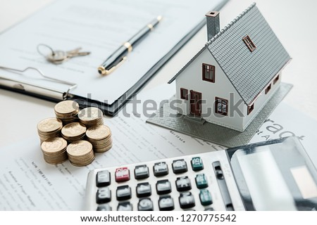 House model with real estate agent and customer discussing for contract to buy house, insurance or loan real estate background. Royalty-Free Stock Photo #1270775542