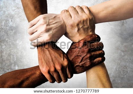 multiracial group with black african American Caucasian and Asian hands holding each other wrist in tolerance unity love and anti racism concept isolated on grunge background #1270777789