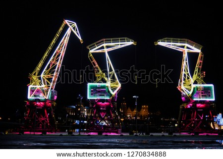 Highlighted cranes in Szczecin, a city monument. Royalty-Free Stock Photo #1270834888