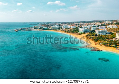 Nissi beach in Ayia Napa, clean aerial photo of famous tourist beach in Cyprus. The best resort area of Cyprus, Nissi beach, the hotels, gulfs, parks. #1270899871