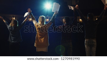 Slow motion of actors and actresses bowing to audience in a theater Royalty-Free Stock Photo #1270981990