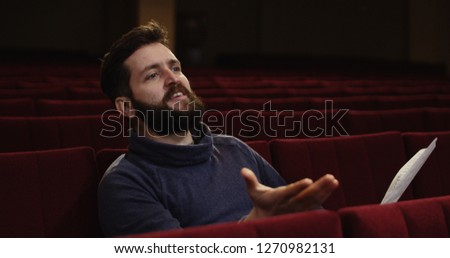 Medium shot of a man directing a scene in the theater #1270982131
