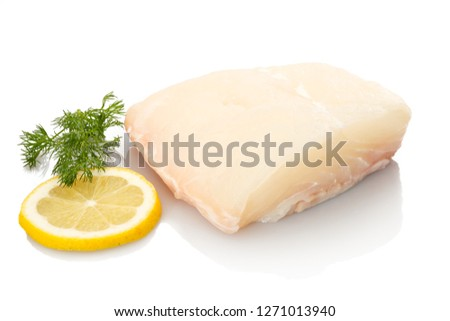 White halibut fisch with lemon an dill white isolated