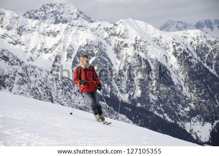 mature man skiing in the mountains in Bruson #127105355