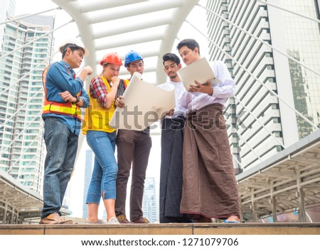 Group of engineer and  burmese businessman meeting and discussion their project work #1271079706