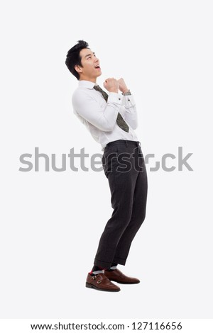 Showing fist young Asian business man isolated on white background. #127116656