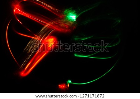 drawing made with light, light painting, traces of light, long exposure black background, drawing with light #1271171872