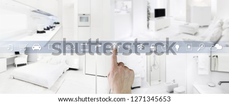 smart home control concept hand touch icons screen with interiors, living room, kitchen, bedroom and bathroom on blurred background, web banner and copy space template #1271345653