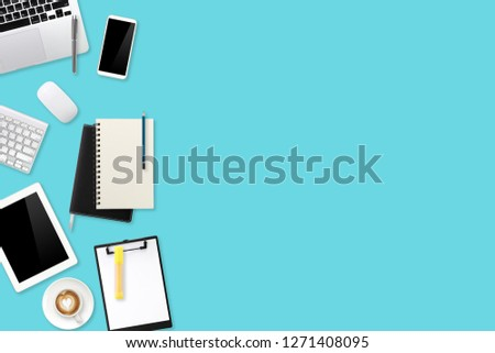 digital marketing work desk with laptop computer, office supplies, coffee cup and cell phone on green pastel background #1271408095