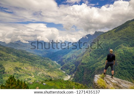 Man standing on top of the hill in Himalayas. Achievement and success. Trekking in Nepal #1271435137
