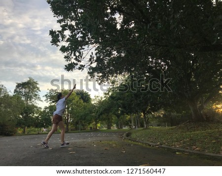 Likas 29 dec 2019 . A girl jumping at a park. Beautiful park with good exercise will give good opportunity to rilek their mind in the same time give a healthy life . #1271560447