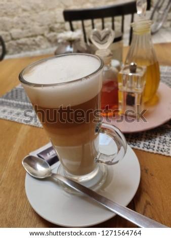 Beautifull produced cappuccino  #1271564764