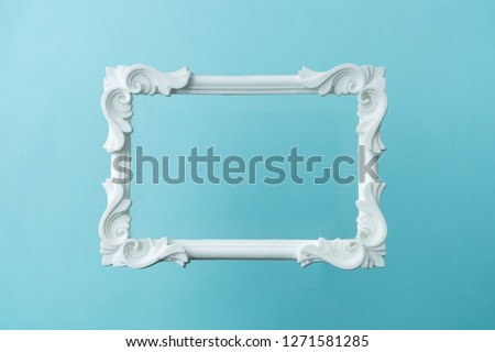 White vintage frame on pastel blue background. Minimal border composition. #1271581285