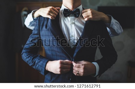 Preparations for the wedding. Fees of the groom. Royalty-Free Stock Photo #1271612791