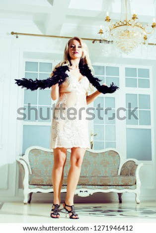 pretty blond woman in rich luxury house interior, fashion people #1271946412