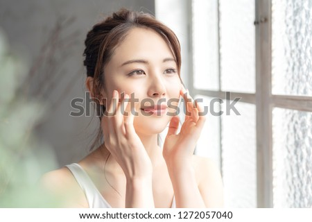 Beauty and skin care concept of a young asian woman. #1272057040