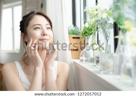 Beauty and skin care concept of a young asian woman. #1272057052