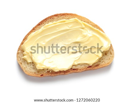Tasty toast with butter isolated on white, top view #1272060220