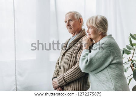 senior couple standing together at home  #1272275875
