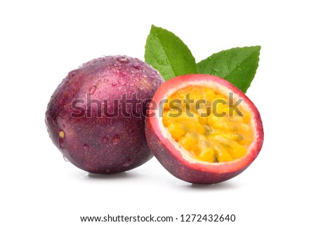 Purple passion fruit (Passiflora edulis) with cut in half and green leaf isolated on white background. Royalty-Free Stock Photo #1272432640