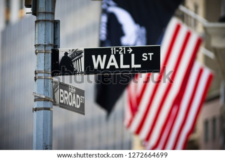 Wall street sign with American flag in the Financial District of Lower Manhattan #1272664699