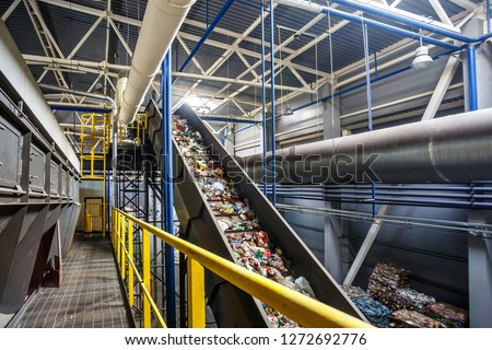 moving conveyor transporter on Modern waste recycling processing plant. Separate and sorting garbage collection. Recycling and storage of waste for further disposal.  #1272692776