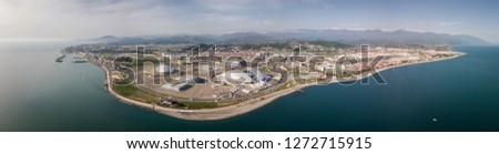 Russia, Sochi - October 15, 2018: SOCHI, RUSSIA Sochi Olympic Fire Bowl in the Olympic Park Aerial. Sochi Olympic Fire Bowl in the Park. Central stella and Stadium Fisht built for Winter Games #1272715915